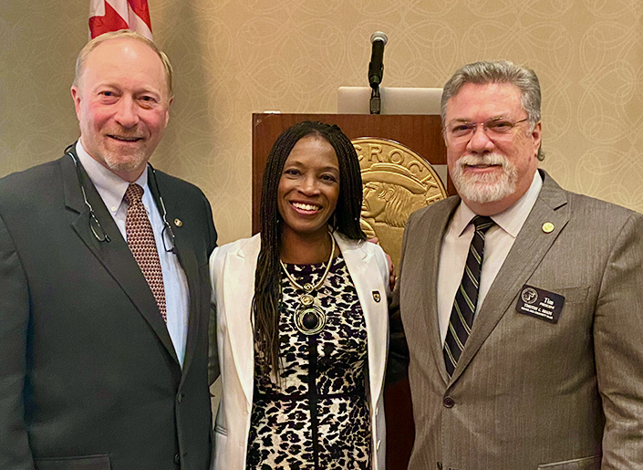 Left to right: B&C Chief of Staff Tony Schoonen, Ms. Skipwith, B&C President Tim Brady. B&C Club photo